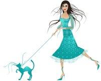 Señora vestida azul con el gato azul Fotos de archivo libres de regalías