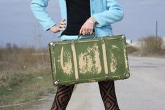 Señora y maleta Foto de archivo libre de regalías