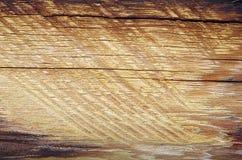 Se av antikt trä av ljus färg i en trävägg Arkivfoto