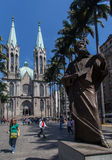 Se Cathedral Sao Paulo Brazil. The twin tower with green copper roofs Se Cathedral, the plam trees and a statue of Anchieta Priest in downtown Sao Paulo, Brazil Royalty Free Stock Images