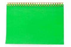 Se cierra para arriba de un cuaderno verde en blanco Imágenes de archivo libres de regalías