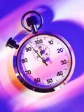 Se divierte el cronómetro en un fondo coloreado Foto de archivo