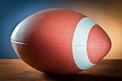 Se divierte la bola de equipment.rugby en la madera Fotos de archivo libres de regalías