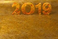2019 se hace en lugar del color oro en fondo de oro imagen de archivo libre de regalías