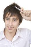 Se peigner le cheveu Images stock