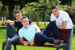 Se reposer de trois garçons Photo stock