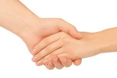 Se serrer la main de deux personnes, d'homme et de femme Photos libres de droits