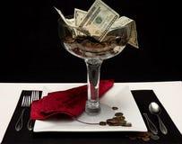 Se sirve el dinero Foto de archivo