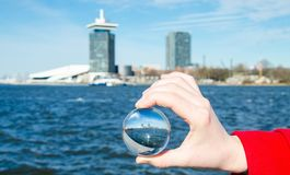 Sea ​​and amsterdam. In glass balls on a sunny day Stock Photo