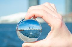 Sea ​​and amsterdam. In glass balls on a sunny day Royalty Free Stock Images