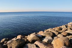 Sea ​​and stones of Malmo. Sea ​​and stones of the modern port area of Malmo stock image
