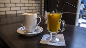 Sea buckthorn tea and coffee at the bar royalty free stock images
