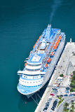 Sea liner moored to a pier. Sea line boat mooring to the pier in the Bay of Kotor, view from above, Montenegro Stock Photos