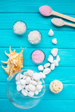 Sea ​​salt in a glass white stones and Shell for spa and relaxation on a blue background Stock Images