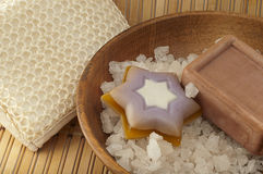 Sea salt in wooden bowl of natural soap, washcloth Stock Photo