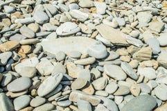 Sea stones on the beach stock photo