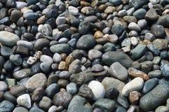 Sea stones in the sun royalty free stock photo