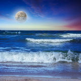 Sea waves breaking on the sandy beach at night Royalty Free Stock Image