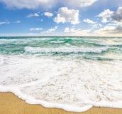 Sea waves breaking on the sandy beach. Sea wave attacks the sandy beach and break on them stock photo