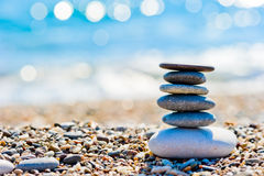 Sea ��shore and the tower of smooth stones Stock Photography