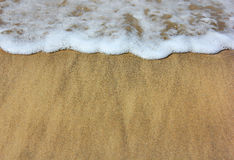 Sea waves and wet sand Stock Images
