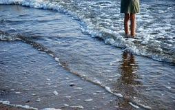 Sea. Girls legs into the sea Stock Photography