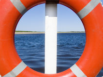 In the sea. Sight through a lifebuoy ring Stock Images