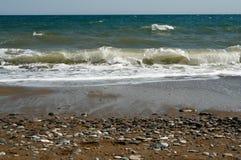 Sea. Colour small stone and sea wave stock image