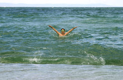 Sea. The teenager bathe in the sea Royalty Free Stock Image