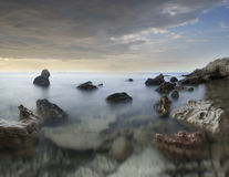 The sea. Seacoast at sunset the sun, summer seacoast Stock Photos