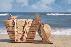 Sea. Women's hat and bag on the beach royalty free stock photo
