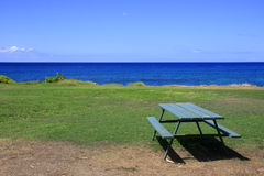 At the sea. Bench and table at oceanside Royalty Free Stock Images
