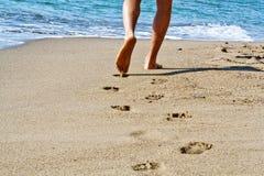 Sea. Hike along the beach with bare feet sea Royalty Free Stock Photography