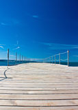 By the sea. Wooden bridge to the sea Stock Photography