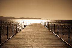 By the sea. Wooden bridge to the sea Stock Image