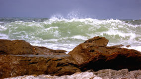 Sea. Rocks waves scum waves sea and sky Stock Photography
