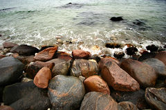 Sea. Water splashing on rocks in denmark Royalty Free Stock Image