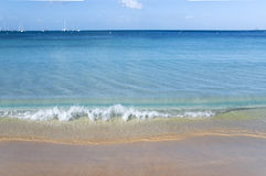 Sea. Blue sea and sand gilded Royalty Free Stock Photos