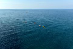 Sea adventure. Group of sea kayakers enjoying beautiful day Stock Image