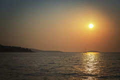 The sea in all its tranquil beauty with sunset Stock Images