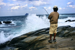 Sea & Angler. On the rocky shore anglers fishing Royalty Free Stock Images