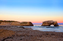 Sea Arch. Formed by wave erosion at Natural Bridges State park at the sunset Royalty Free Stock Photos