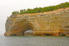 Sea Arch in a Sandstone Cliff. In Pictured Rocks National Lakeshore on Lake Superior, in Northern Michigan Royalty Free Stock Photography