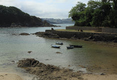 Sea armlet during the low-tide. Sea armlet near La Coruna with the anchored boats during the low-tide Stock Photo