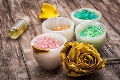 Sea aromatic salt for spa treatments. On the background of yellow rose buds Stock Photography