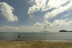 Sea atmosphere at Sairee Beach, Chumphon Province, March 2019.The sea and the beach at noon. The bright sky, the clouds are