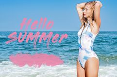 Beautiful tanned woman in swimsuit with raised hands on the tropic beach. Sea background with letters hello summer. Ocean. Beautiful tanned woman in swimsuit royalty free stock photo