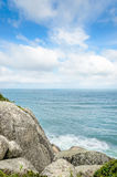 Sea background with some big stones and a blue sky background. Royalty Free Stock Images