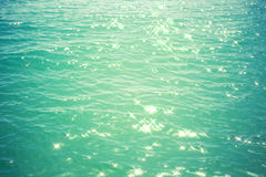 Sea background - turquoise water with glare of light Stock Photography