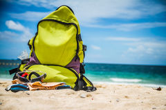 Sea. Backpack Yellow Sea Beach Beauty Rest Sand Glasses Slates Heat Royalty Free Stock Photography